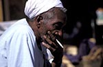 Egypt;Egyptian;_aged;arid;Aswan;cigarette;deserts;elderly;male;man;Man;mature;men;Middle_East;Near_East;Nile;North_Africa;older;people;Egyptians;Arabs;Arabic;person;persons;rivers;seniors;smoking;streams;water;cigarette;Man;smoking