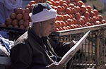 Egypt;Egyptian;Tomato_vendor_reading;newspaper;Aswan;arid;bazaar;souk;markets;marketplaces;deserts;male;man;markets;marketplaces;vendors;sellers;merchants;salespersons;retailers;shopping;men;Middle_East;Near_East;newspaper;Nile;North_Africa;people;Egyptians;Arabs;Arabic;person;persons;reading;rivers;streams;Tomato;vendor;water