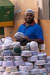 Egypt;Egyptian;Hat_vendor;Aswan_Souq;Aswan;arid;bazaar;souk;markets;marketplaces;deserts;markets;marketplaces;vendors;sellers;merchants;salespersons;retailers;shopping;Nile;North_Africa