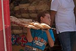 Egypt;Egyptian;Boy;pita_bread;souk;Aswan;arid;bazaar;souk;markets;marketplaces;deserts;markets;marketplaces;vendors;sellers;merchants;salespersons;retailers;shopping;Nile;North_Africa