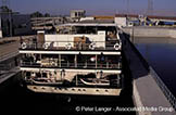 River_cruise_boat;_Esna_locks;_Nile_River;_Qina;_Arabians;_Arabs;_arid;_boat;_boats;_cruise;_cruise_ships;_cruising;_deserts;_Egypt;_Egyptians;_Esna;_holidays;_liner;_locks;_marine;_Middle_East;_Near_East;_Nile;_North_Africa;_Qina;_River;_rivers;_streams;_tourism;_transportation;_travel;_vacations;_vessels;_water;_Africans