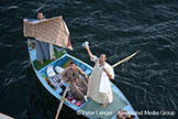 Man;_boat;_Nile_River;_textiles;_Esna;_Qina;_Africans;_Arabians;_Arabs;_arid;_boats;_vessels;_transportation;_deserts;_Egypt;_Egyptians;_Esna;_locks;_man;_men;_male;_person;_people;_Middle_East;_Near_East;_Nile;_North_Africa;_Qina;_River;_rivers;_streams;_water