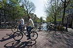 Amsterdam;Benelux;bridge_Herengracht;Cyclists;Dutch;Europa;Europe;Holland;male;man;men;Netherlands;people;person;Seventeenth_century_canal_ring_area_of_Amsterdam_inside_the_Singelgracht;UNESCO;World_Heritage_Site