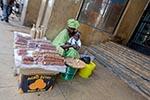 Senegal;Senegalese;Africa;Africa;babies;baby;childhood;children;infants;marketplaces;markets;merchants;people;person;persons;retailers;salespersons;sellers;shopping;tots;vendors;woman;women;female;person;people;Dakar;Nut;vendor