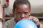 Africa;boy;boys;child;children;youngsters;kids;childhood;person;people;boys;childhood;children;kids;people;persons;Southern_Africa;youngsters;Swaziland;Swazi;Lubombo;balloon