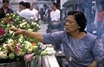 Thailand;Thai;Siam;Siamese;Southeast_Asia;Asia;beliefs;Buddhism;Buddhist;creed;faith;female;people;person;persons;people;religion;woman;women;Bangkok;People;flowers_Temple;Emerald_Buddha;Emerald;Buddha